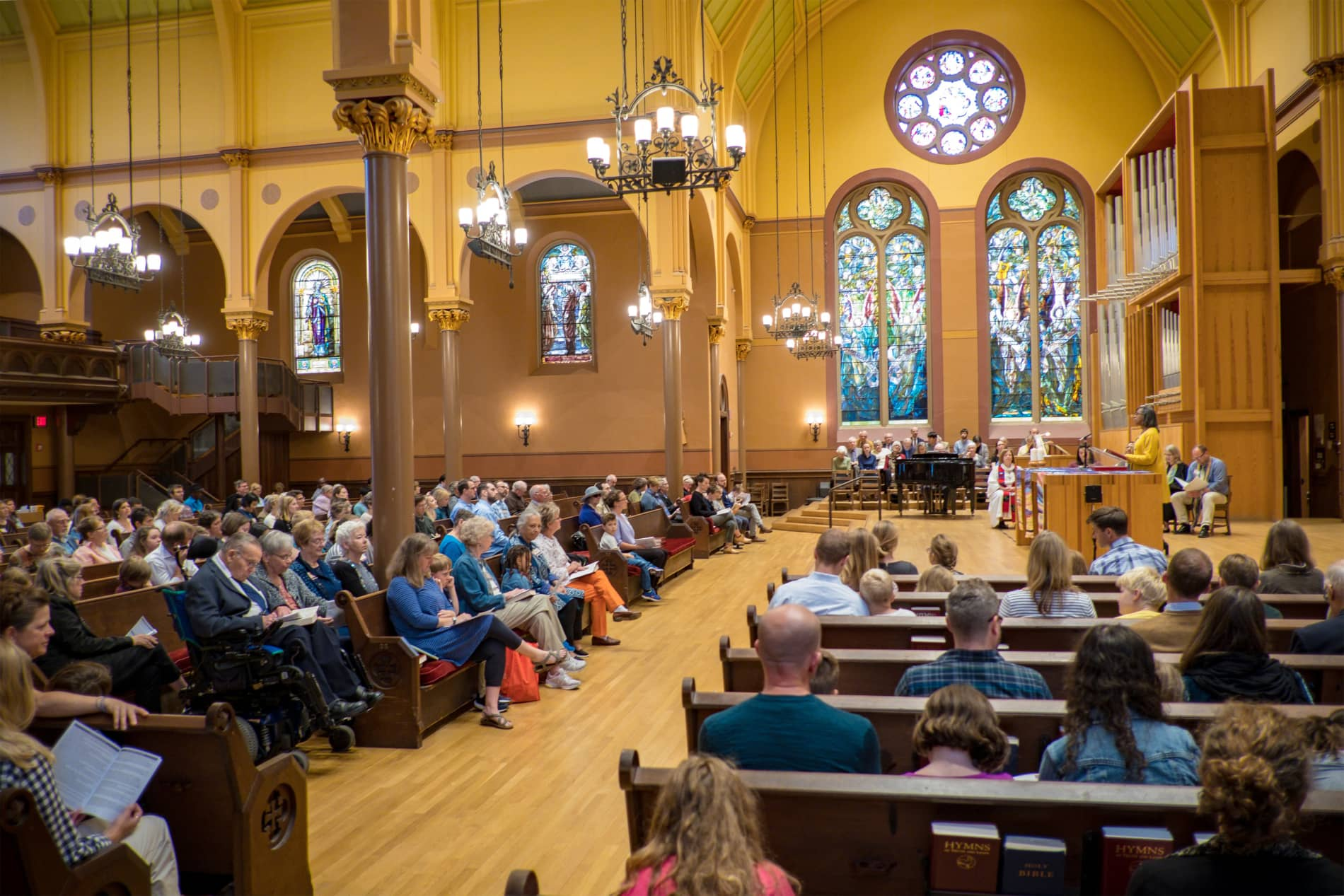 The sanctuary of First Church Cambridge filled with Sunday worshippers