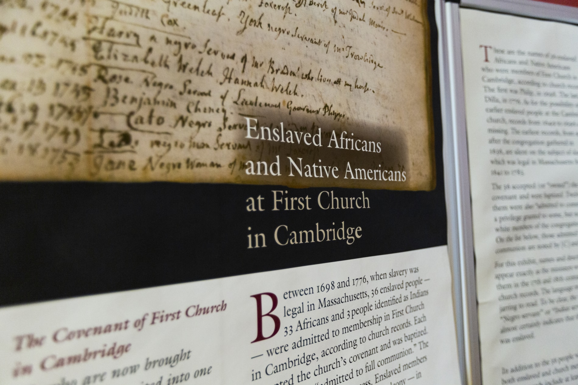 An wall panel detailing the history of Enslaved Africans and Native Americans at First Church in Cambridge