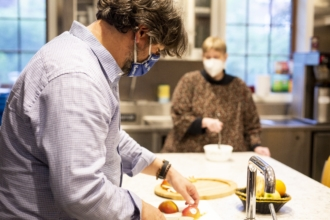 A man preps a meal for people experiencing food insecurity