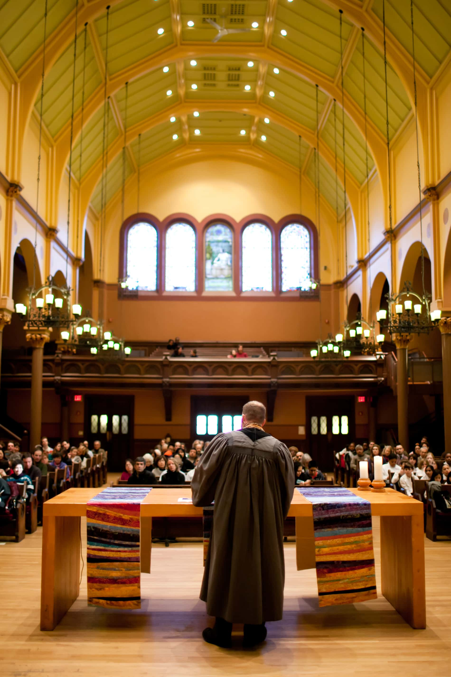 A wide angle view showing the congregation in worship in the First Church sanctuary