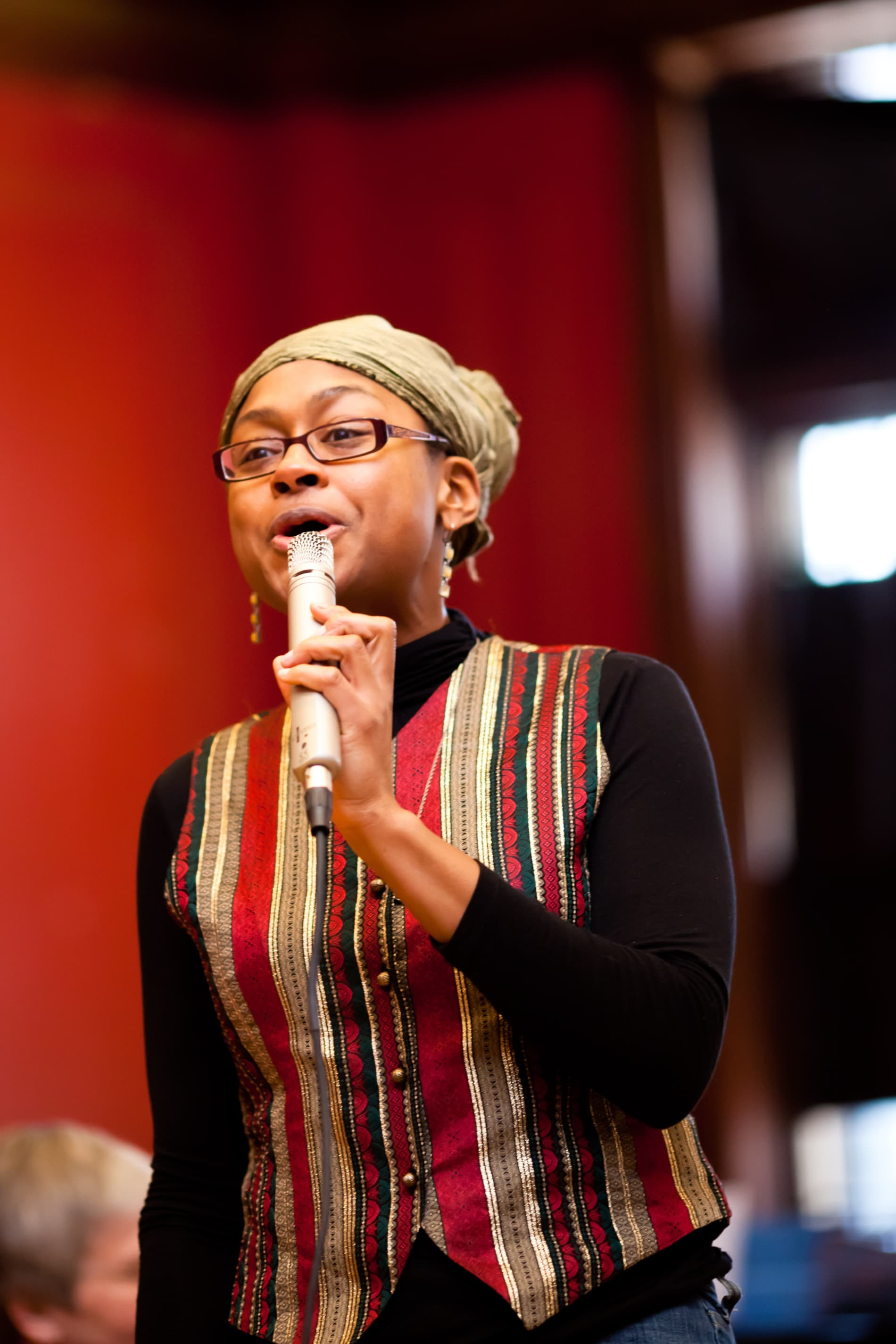 A Black woman speaks into a microphone