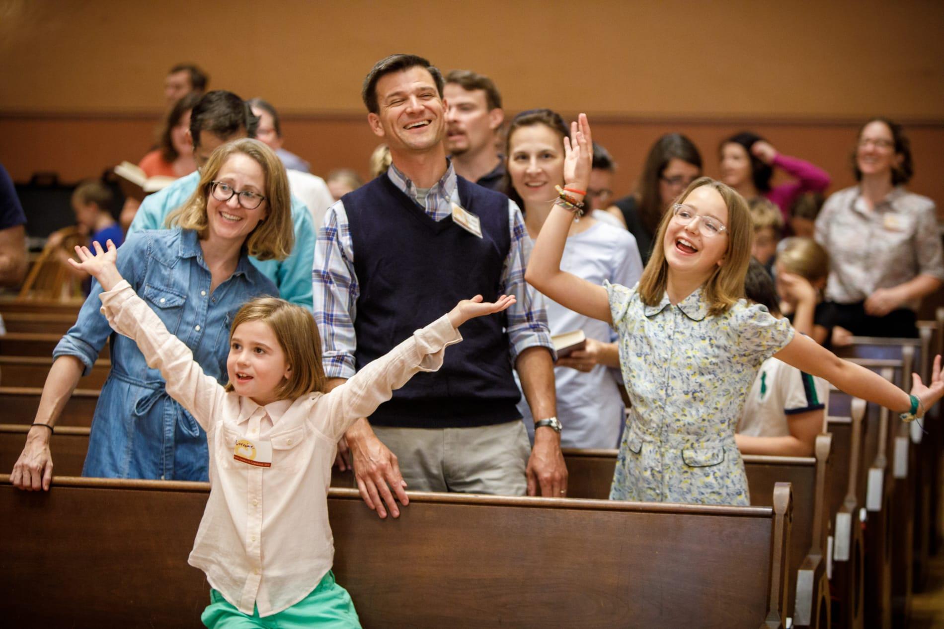 family dancing in worship