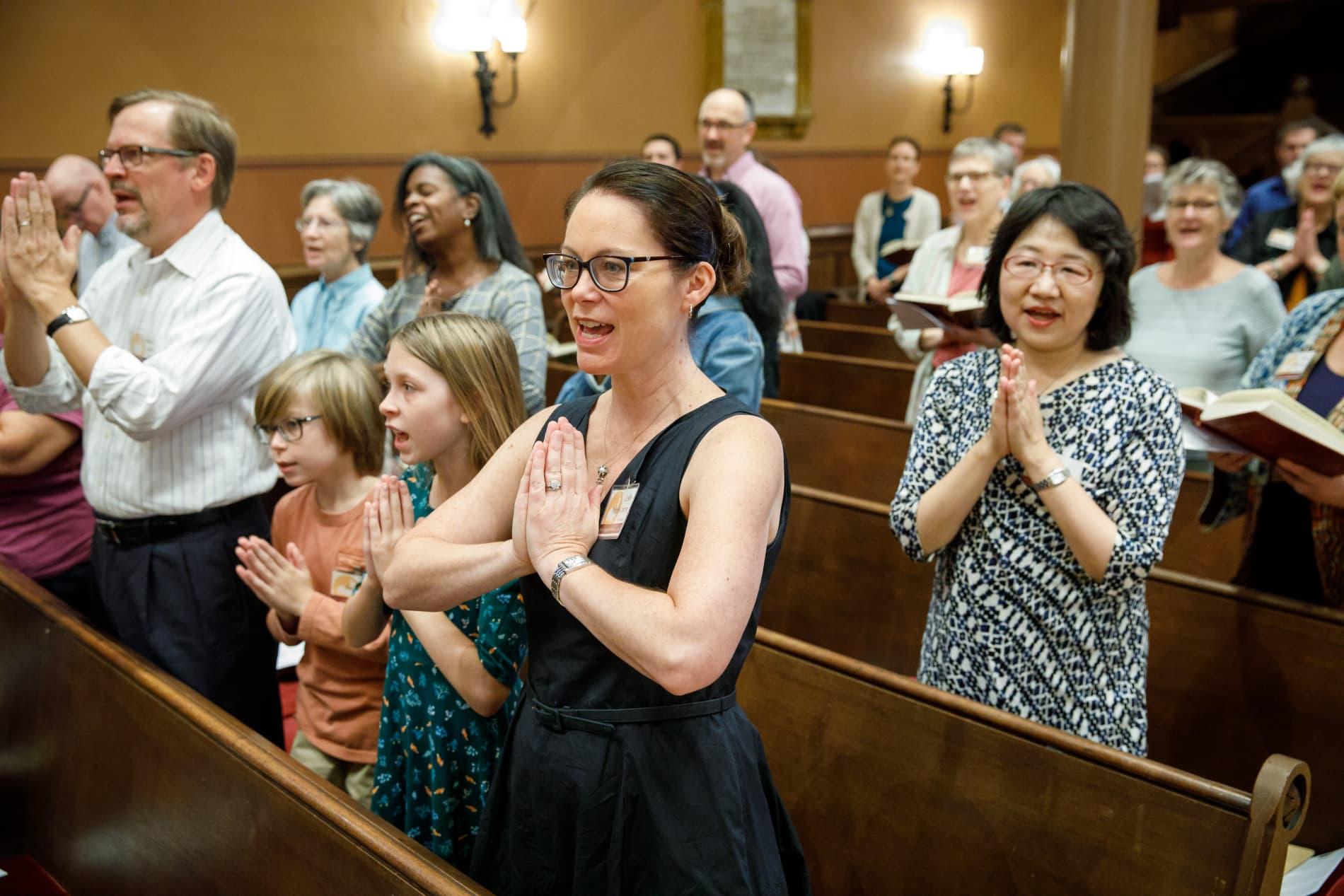 people worshiping in church