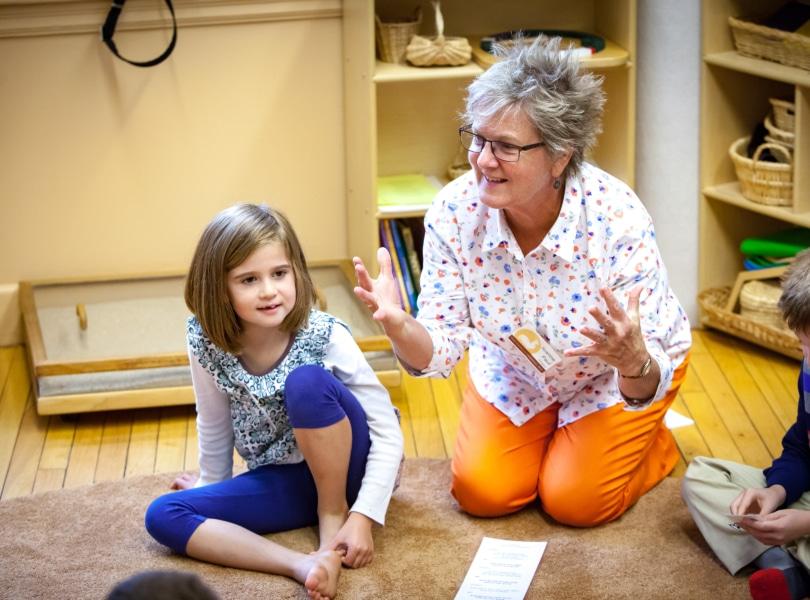 teacher and students in church school classroom