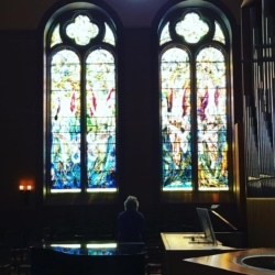 woman reflecting in a sanctuary