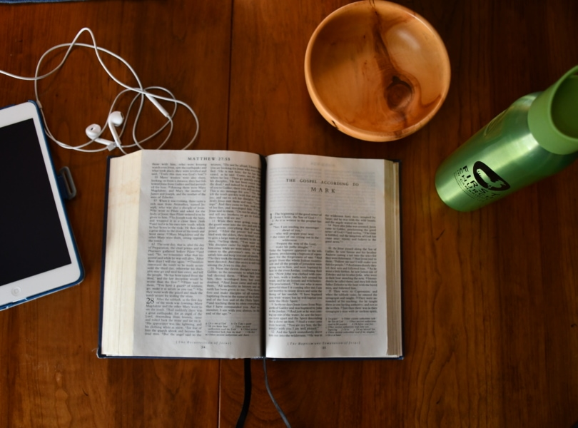 picture of a bible and ipad on a table