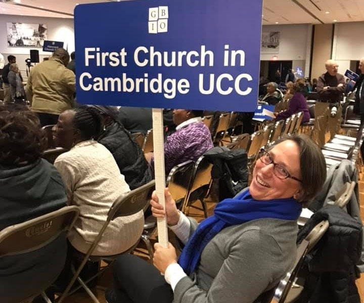 a person holding a sign at an event