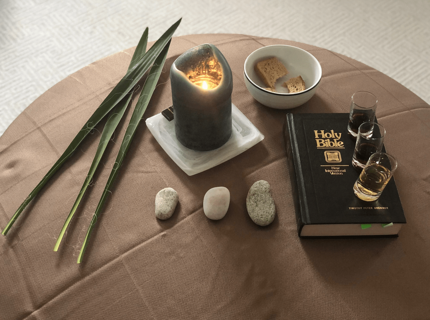 home altar with leaves and candle