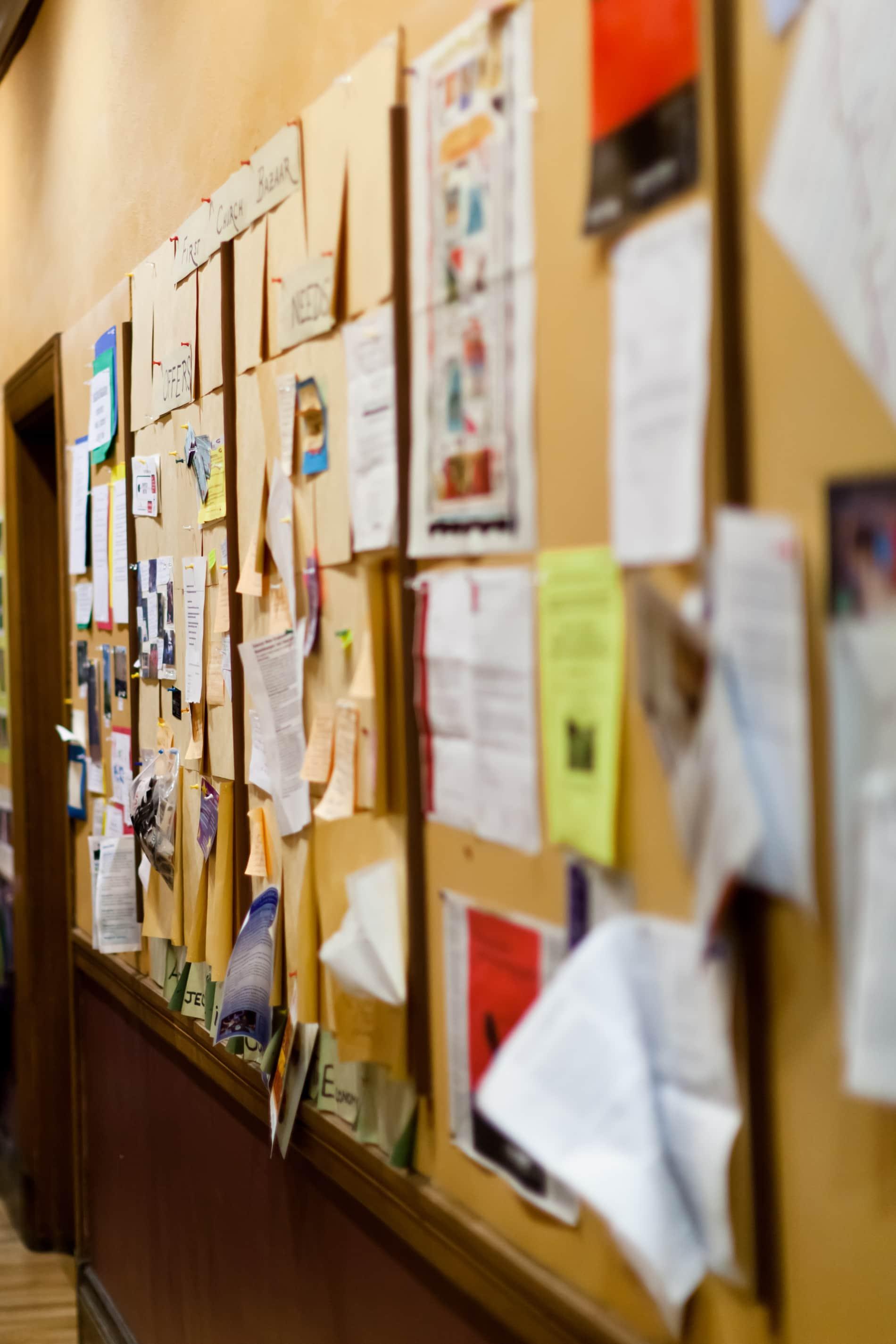 fliers on a bulletin board