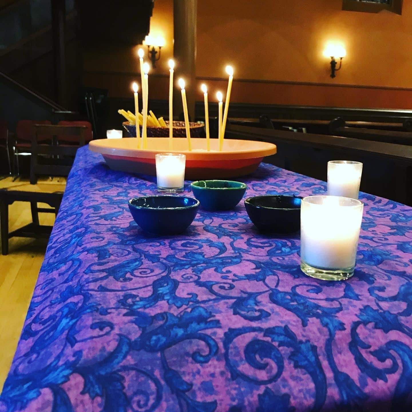 altar table with ashes and candles