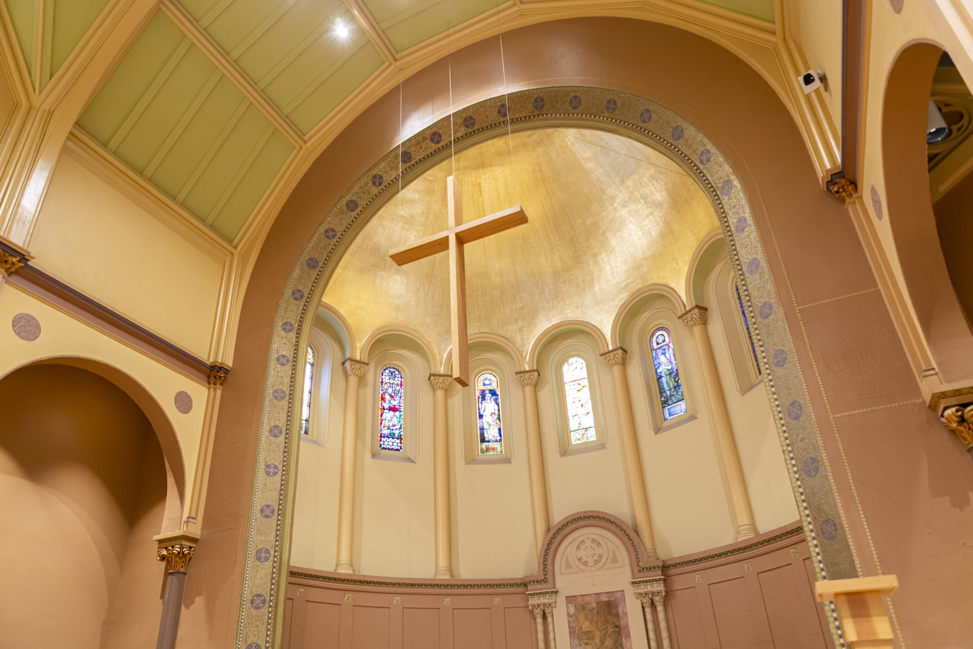 a picture of the cross hanging from the ceiling