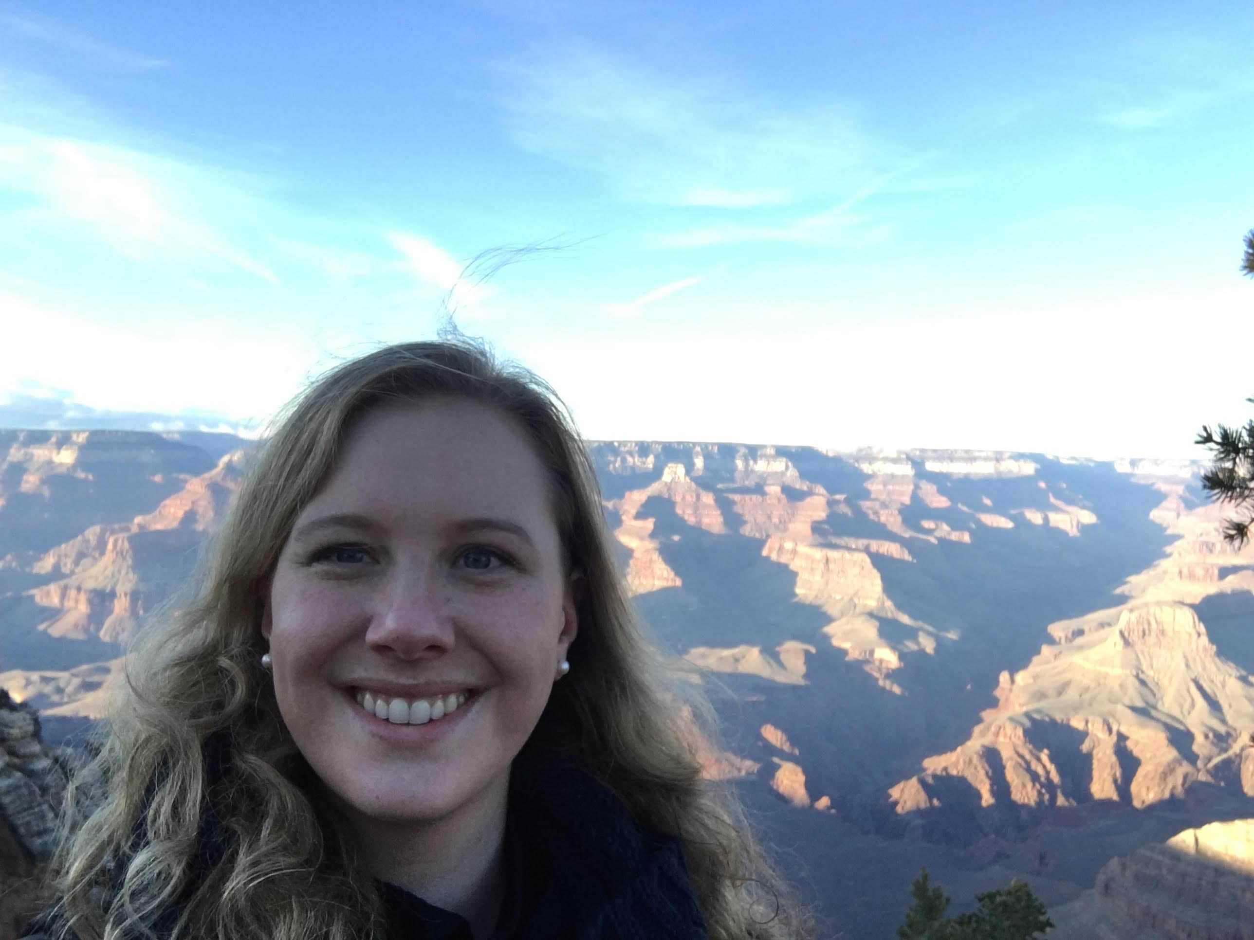 picture of woman near grand canyon