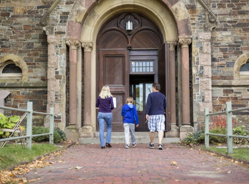 family walking towards church door